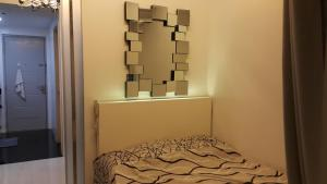 A bed or beds in a room at 1Br Condo Unit The Grass Residences SM North Qc