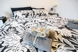 A bed or beds in a room at Angilberto Confortable Apartment