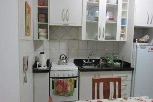 Una cocina o zona de cocina en Gregoleti Canasvieiras. 1 quarto