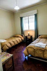 Una cama o camas en una habitación de Céntrico amplio y luminoso