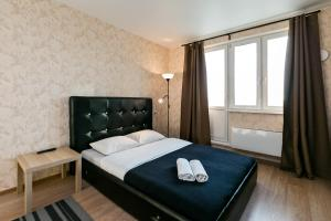 A bed or beds in a room at MaxRealty24 Putilkovo