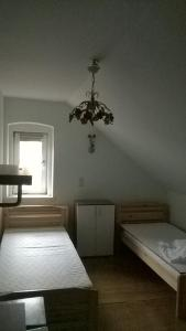 A bed or beds in a room at Raisa Apartments Fünkhgasse