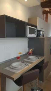 A kitchen or kitchenette at SNC1018 MODERN BOUTIQUE APARTMENT