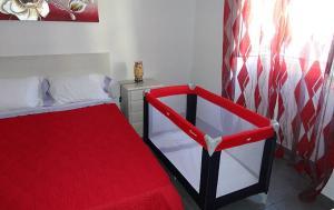 A bed or beds in a room at Casa das Palmeiras