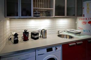 A kitchen or kitchenette at Appartement Disneyland paris