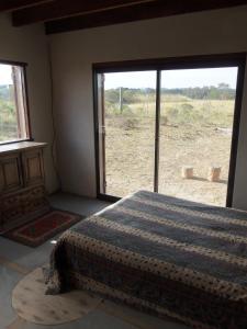 Una cama o camas en una habitación de Cabaña con Vista al Mar