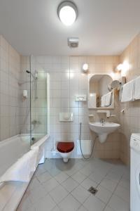 Vonios kambarys apgyvendinimo įstaigoje Barbacan Apartments