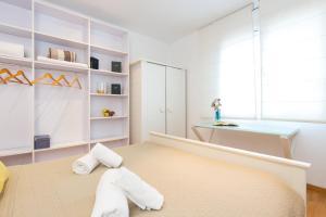 Ein Bett oder Betten in einem Zimmer der Unterkunft Key Sagrada Familia Apartments