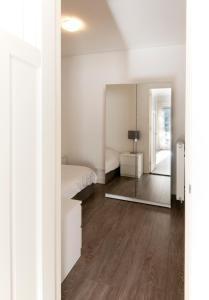 A bed or beds in a room at Luxury Apartments