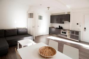 A kitchen or kitchenette at Luxury Apartments