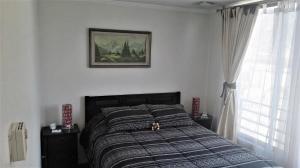 Cama o camas de una habitación en Metro Manuel Montt