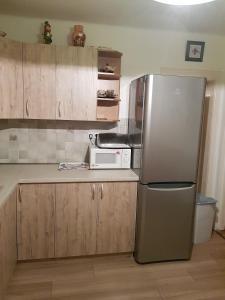 Kuchyň nebo kuchyňský kout v ubytování Drevenica Spanka