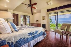 A bed or beds in a room at Mauna Kea Fairways North #16 by South Kohala Management