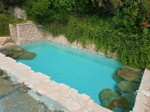 A view of the pool at Villa d'Ortoli 2 or nearby