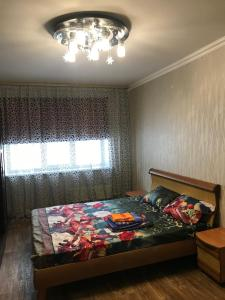 Кровать или кровати в номере 40 лет победы д 3