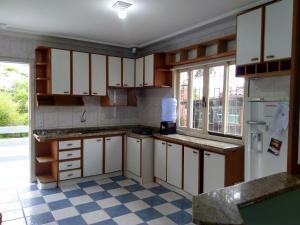 Una cocina o zona de cocina en Casa de Férias