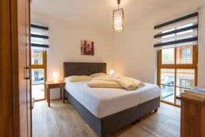 A bed or beds in a room at Schönblick Mountain Resort & Spa