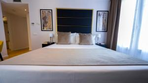 A bed or beds in a room at L&H Gran Vía Selection