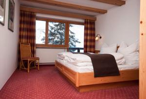 A bed or beds in a room at Appartementhaus Leitner