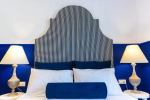 Ein Bett oder Betten in einem Zimmer der Unterkunft Georgioupolis Plaza Suites