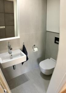 A bathroom at Bright stylish apartment right in a city centre
