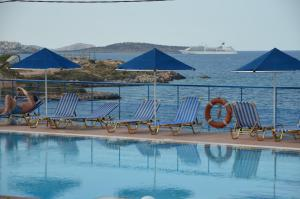 The swimming pool at or near Poppy Villas