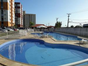 The swimming pool at or near Ap Beija Flor