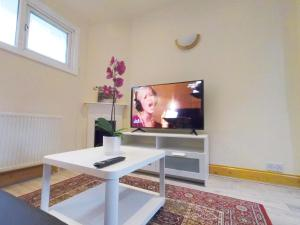 A television and/or entertainment center at Flat 2 at 6 Tauton Mews