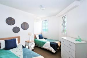 A bed or beds in a room at Indigo Blue