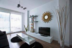A television and/or entertainment center at Cool Loft Malvarrosa Beach