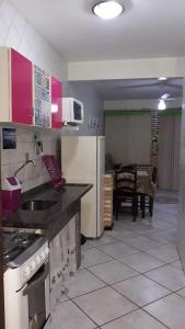 A kitchen or kitchenette at Residencial Parati