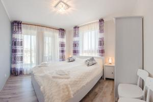 En eller flere senger på et rom på Apartamenty Sun & Snow Aura