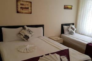 Кровать или кровати в номере Berce Apartments