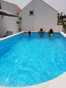 The swimming pool at or near Casas do Patheo