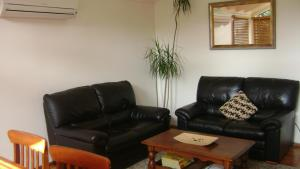 A seating area at Accommodation Sydney North - Forestville 4 bedroom 2 bathroom house