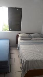 Cama o camas de una habitación en Flat Champagne