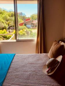 Una cama o camas en una habitación de LA RADA Alameda 204