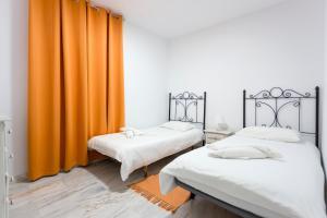 Cama o camas de una habitación en Pier 1 Apartment