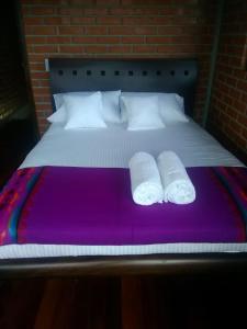 A bed or beds in a room at Chalet la Bonita