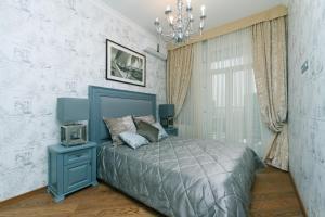 Lova arba lovos apgyvendinimo įstaigoje Luxrent Apartments on Palace Ukraina Ocean Plaza