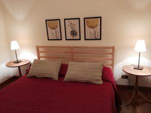 Postel nebo postele na pokoji v ubytování Pigneto Suite