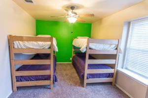 A bunk bed or bunk beds in a room at Helotes Family Retreat