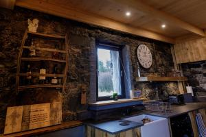 A kitchen or kitchenette at Lusa Bothy