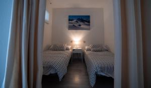 Cama o camas de una habitación en Apartamentos Pirineos Rent