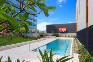 The swimming pool at or near Keeping Cool on Connor - Executive 2BR Fortitude Valley apartment with pool and views