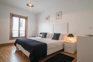Cama o camas de una habitación en ARTS IN City Apartments Ponte Nova