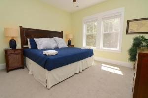 A bed or beds in a room at Beacon Villas at Corolla Light Resort by KEES Vacations