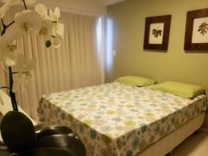 A bed or beds in a room at Barrabali Barra de São Miguel 326