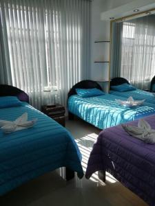 Cama o camas de una habitación en Cusco Apartament