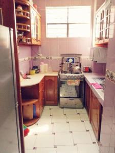 Una cocina o zona de cocina en Cusco Apartament